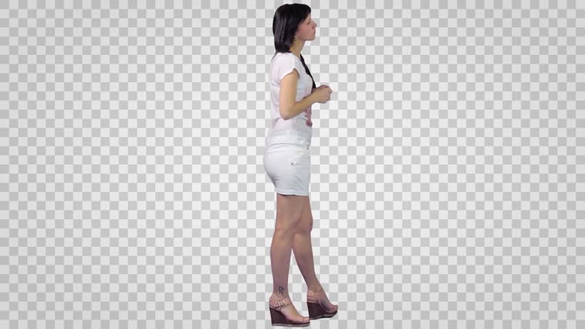 Brunette Girl in white shirt and short skirt. Side view 2. Footage with alpha channel.