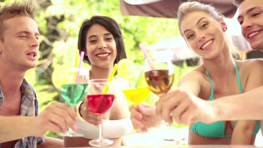 Dinner Party Video Part - 20: Two Young Couples Of Friends At Water Park In Summer Day Are Drinking  Cocktails At Bar