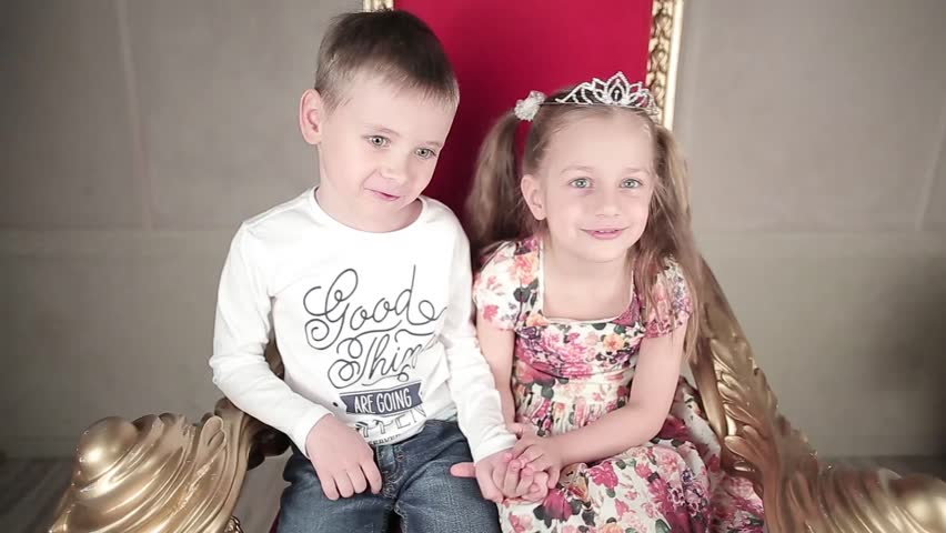 Stock video of little girl kissing a little boy 8727385 shutterstock hd0012boy and girl sitting on a throne looking at each other and smiling to camera altavistaventures Choice Image
