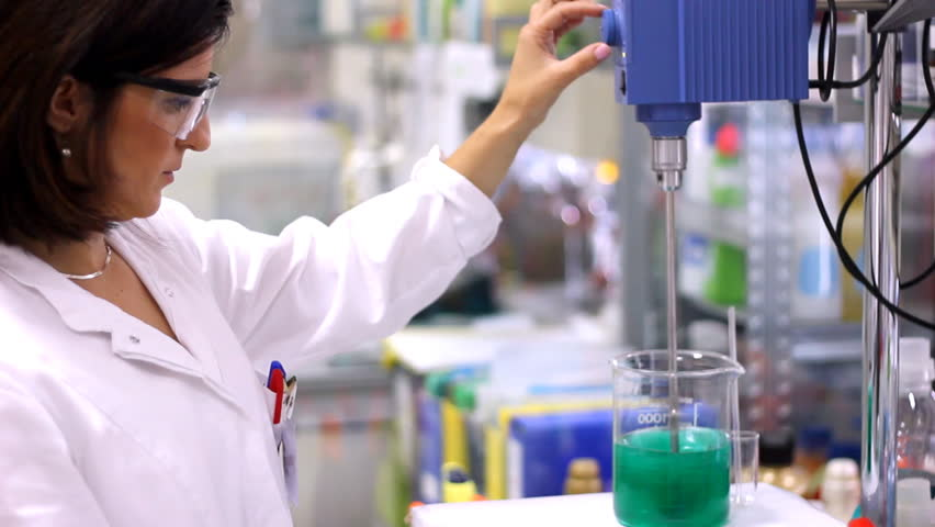 Chemist Working With Lab Mixer And Mixing Chemicals In Laboratory ...