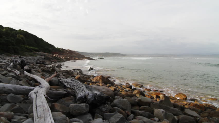 Rocky coast, Wide beauty shot. Knysna, South Africa. 1080p HD with natural sound.