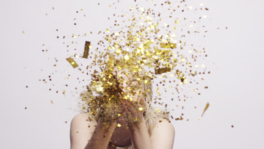Beautiful woman blowing gold glitter confetti slow motion - Red Epic Dragon