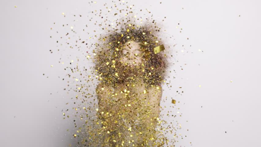 Beautiful hispanic woman blowing gold glitter confetti slow motion - Red Epic Dragon | Shutterstock HD Video #8784205