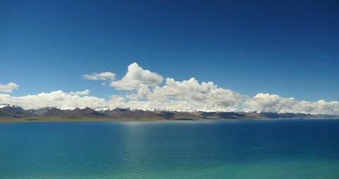 4k time lapse of huge clouds mass rolling over lake namtso & Tanggula snow mountain peak,tibet mansarovar,Tibet's second largest lake,is the third largest saltwater lake in China.gh2_09454_4k