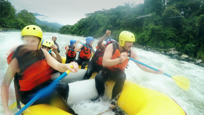 Adult caucasian family having fun on white water rafting trip, on board mounted camera , model released high quality footage with sound | Shutterstock HD Video #8833309