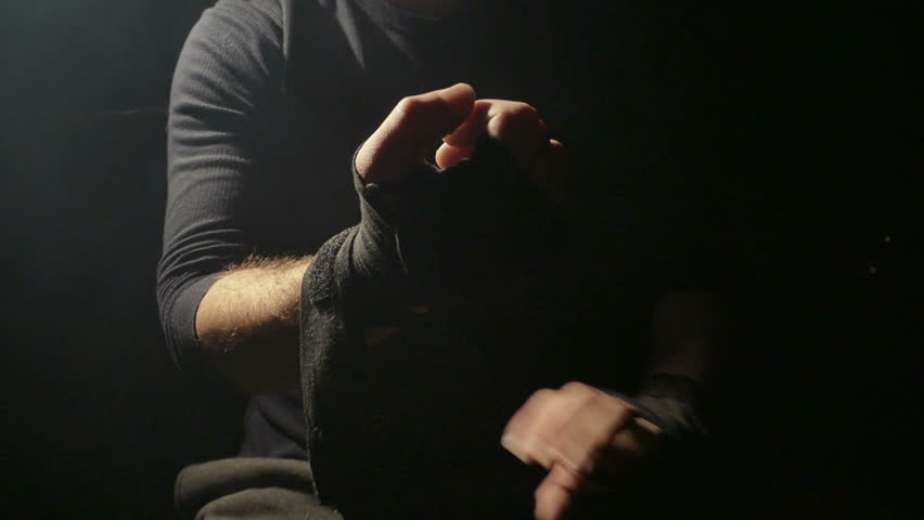 Man Boxer Wrapping Hands Getting Ready for a Fight