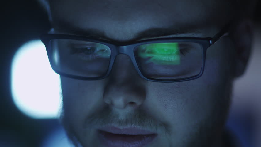 Computer Screen Reflection in Programmer's Glasses Shot on RED Cinema Camera in 4K (UHD). Its easy scale, rotate and crop without loosing quality.