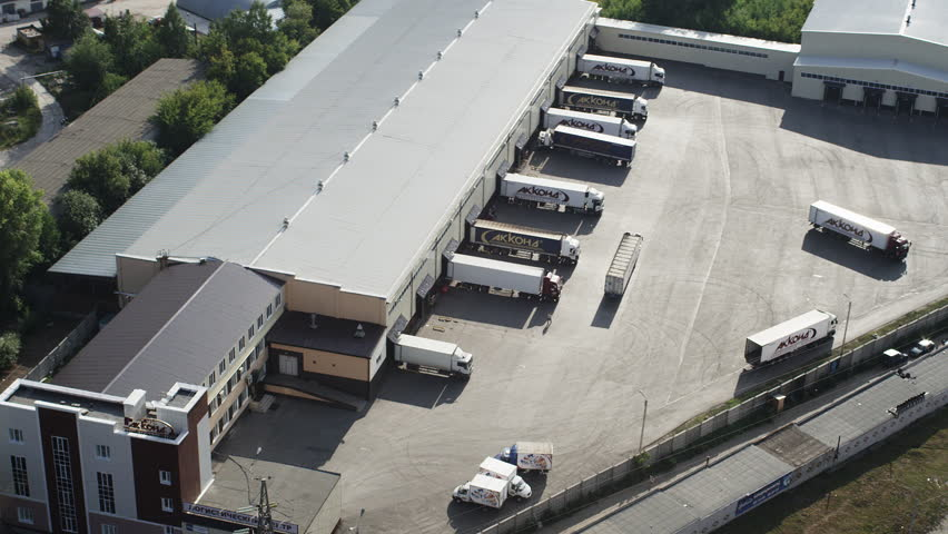 Aerial shot trucks at loading