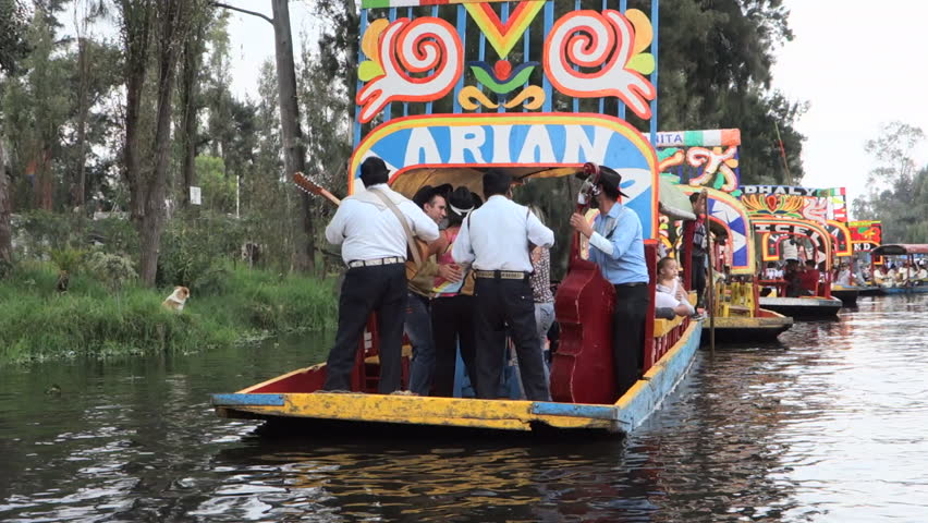 MEXICO CITY - XOCHIMILCO - CIRCA NOVEMBER 2014 - Party boats on the canals that run alongside the restaurants, nurseries and flower markets of the neighbourhood of Xochimilco.