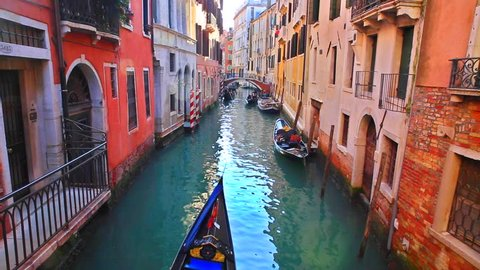 Romantic tour in gondola, rowed by a gondolier in the venice canal.