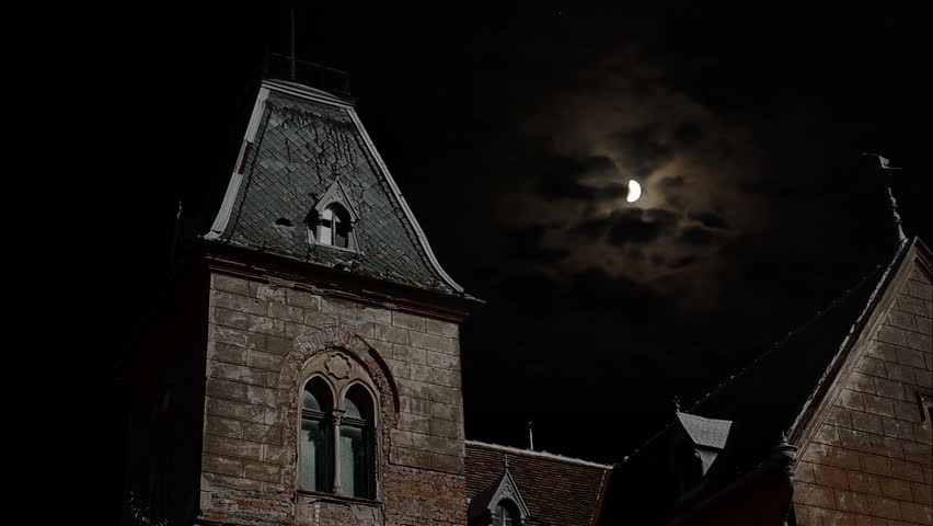 "Abandoned old ""possible"" ghosts haunted place, shot nighttime with moon and clouds in background. Suitable for horror/ghosts/crime/scary stories."