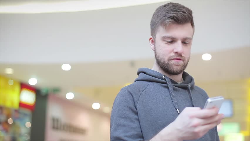 Young Man Wrote on the Phone and Smiling | Shutterstock HD Video #8947489