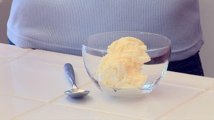 Woman making ice cream sundae