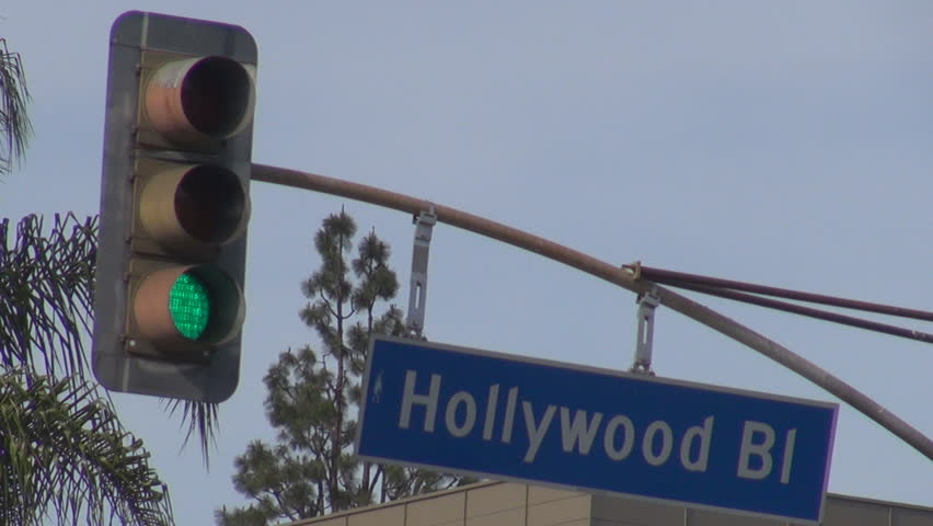 Hollywood sign boulevard and traffic light in sunny day