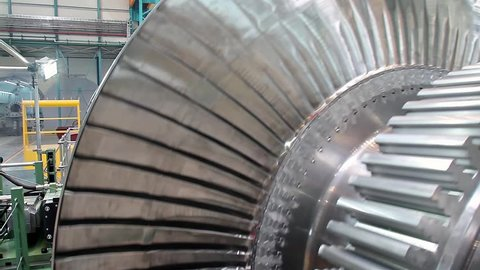 Turbine rotates at a plant producing power steam turbines