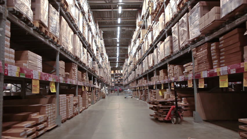 Multi level warehouse with racks full of goods and materials