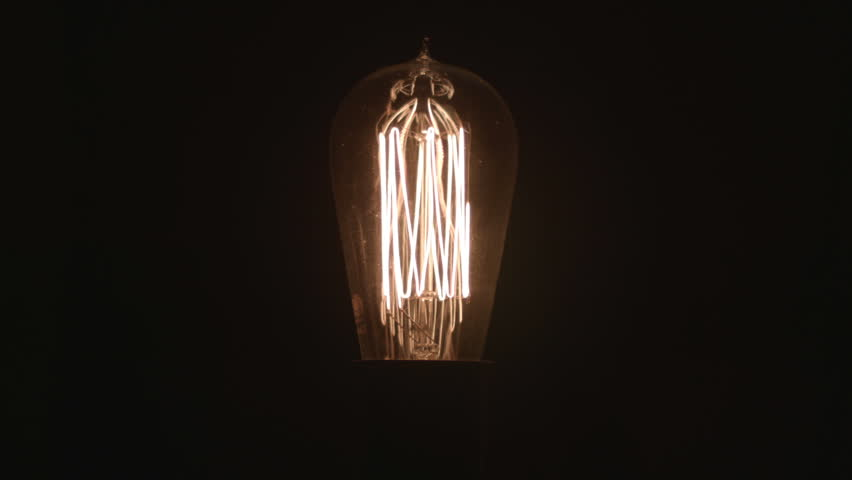Old fashioned lightbulb turns on and off, like a bright idea | Shutterstock HD Video #9004480