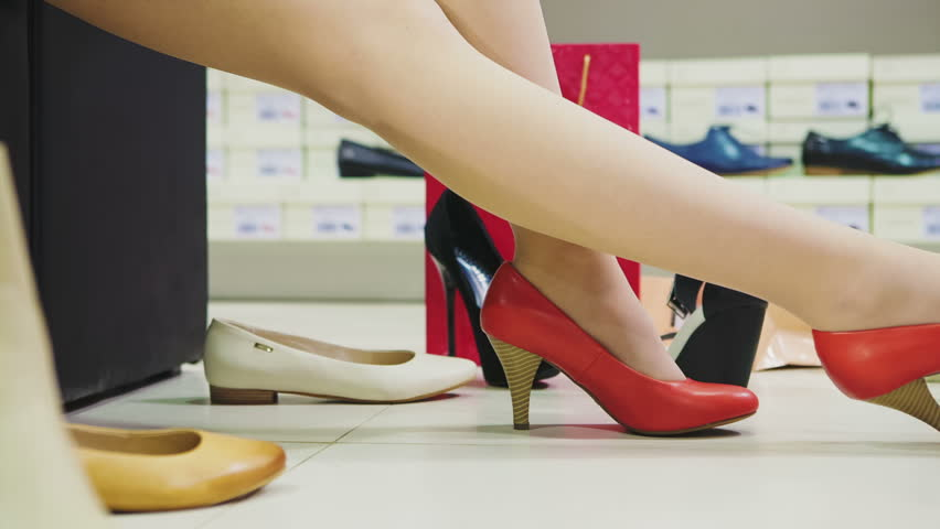 Young woman trying on shoes in shop | Shutterstock HD Video #9004645