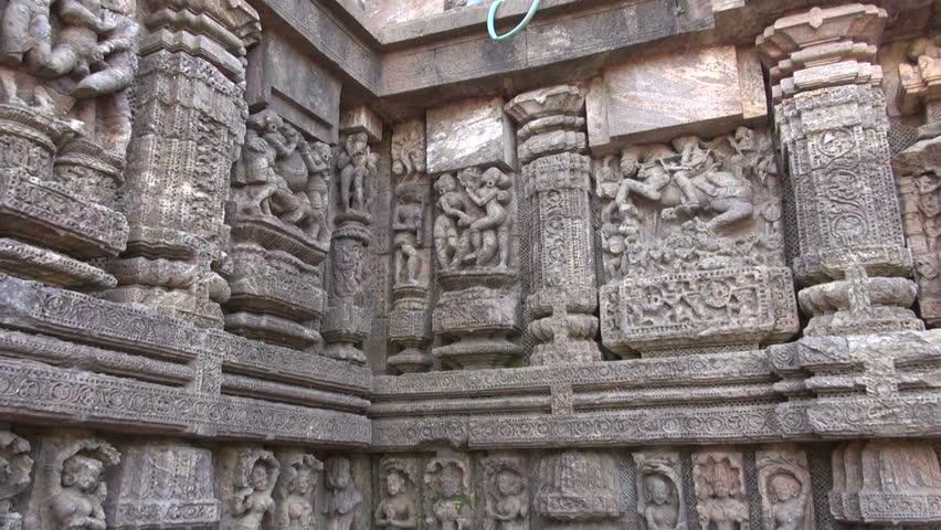 ancient erotic sacred art sculptures on Konark sun temple wall, Odisha, India