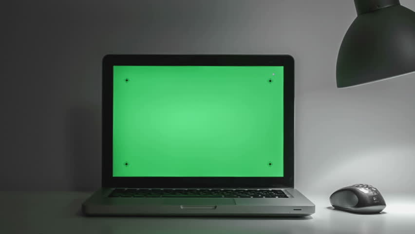 laptop on a table with a green screen hd stock video clip