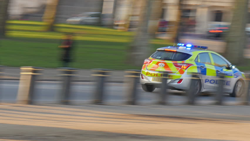 A police car running so fast in London street The police car with siren is on to get and solved a crime