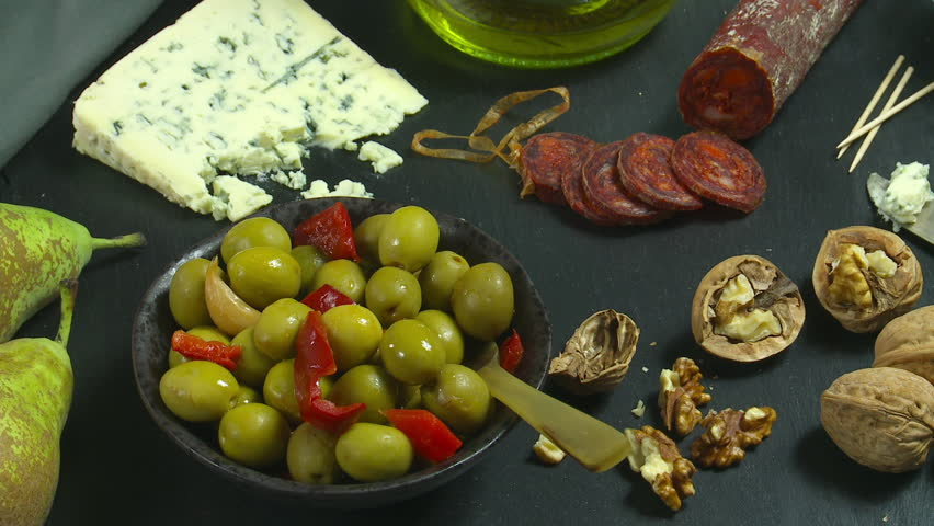 Spanish tapas or snacks with olive oil pouring. Food