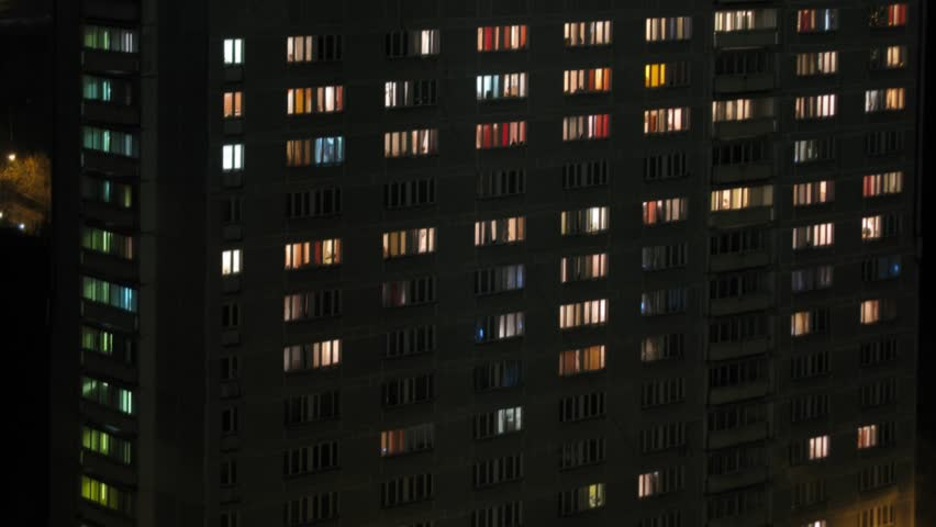 Closeup of turns on and off the light in the windows College at evening. Time lapse.
