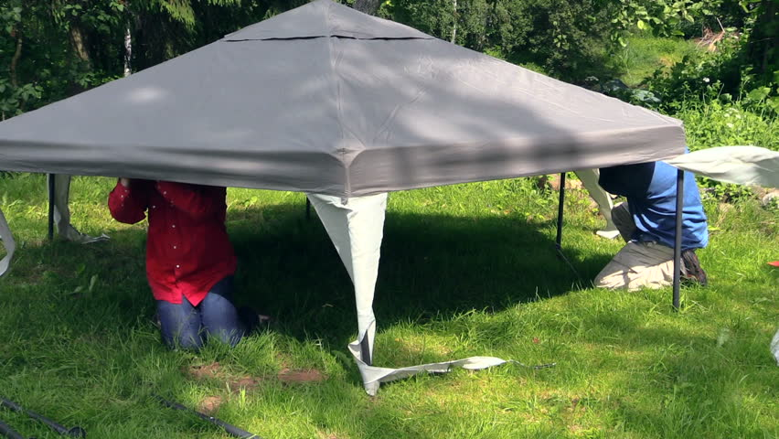 men crawled under the gazebo canvas top fixes metal structure on country yard. Shot on & People Fix Garden Tent Bower Long Metal Legs. Protection From Sun ...