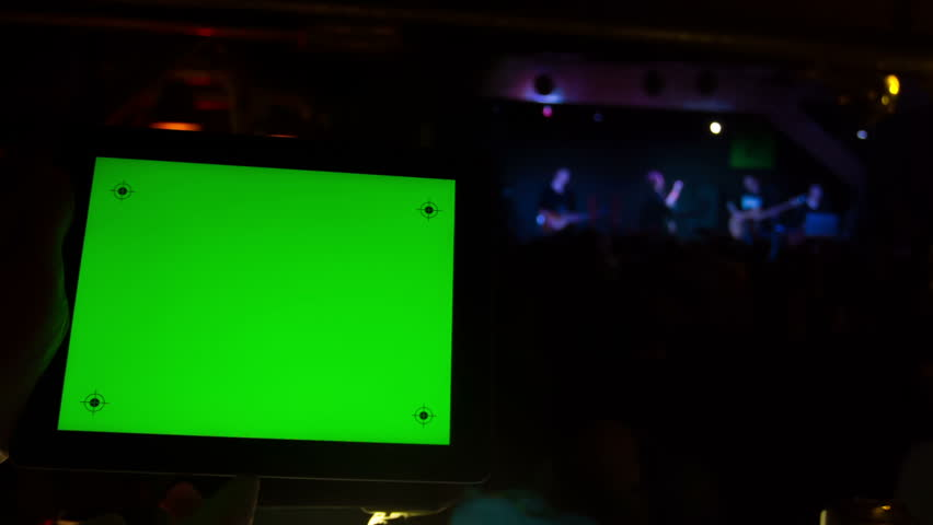 Men use the tablet with a green screen at a concert in a nightclub.   Shutterstock HD Video #9122240