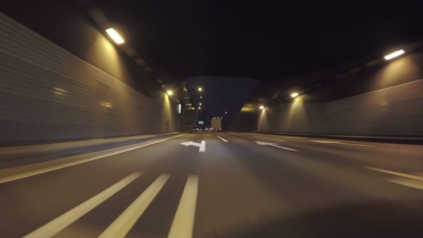 Nightscape drive through Tokyo's modern reclaimed lands on the Bayshore Highway. 3 lane highway tunnel under the Tokyo Bay towards downtown Tokyo. | Shutterstock HD Video #9127070