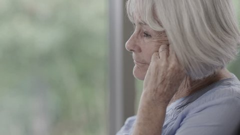 4K Portrait of lonely senior lady alone with her thoughts