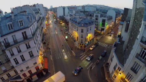 PARIS - SEP 11, 2014: City traffic on crossroad of Rue La Fayette with Rue Louis Blanc and Du Faubourg Saint-Martin Street at morning. Aerial view. Du Faubourg Saint-Martin street length is 1886 m.