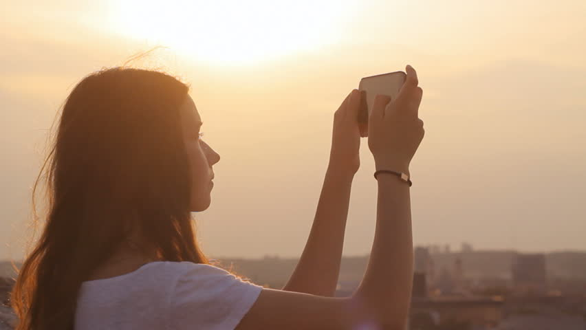 Girl taking a photo from above in the city, horizon | Shutterstock HD Video #9151790