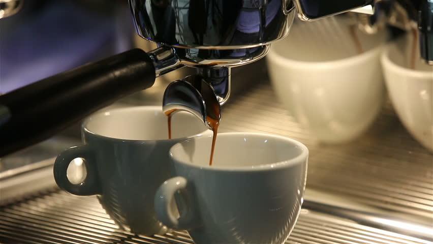 38075a44f01 hd00:19Barista makes coffee in the coffee machine. White coffee mugs.