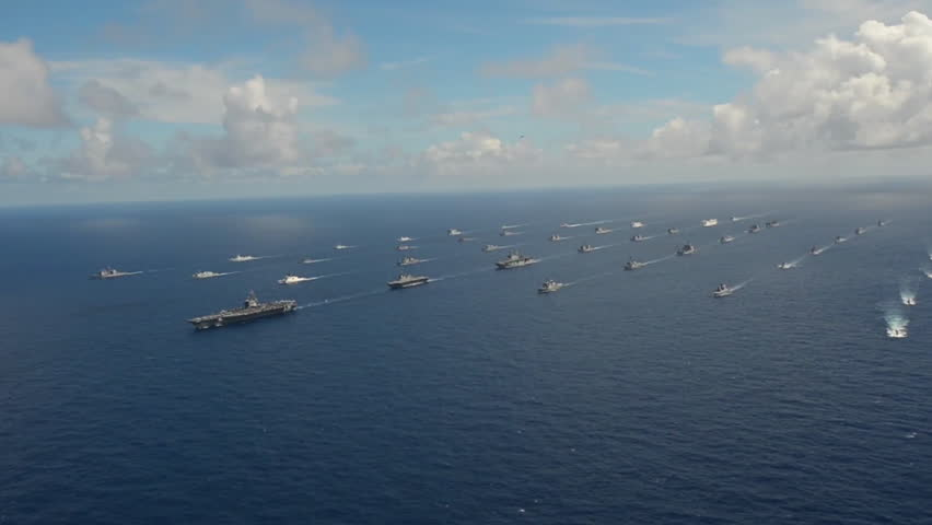 CIRCA 2010s - Aerial of massive flotilla of Navy ships on the move across the Pacific.
