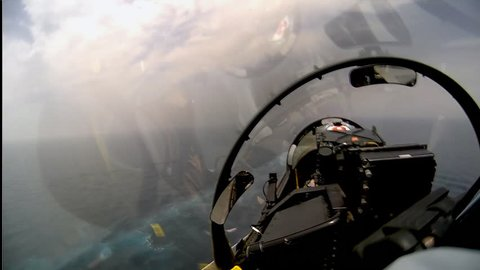 CIRCA 2010s - POV shot of a fighter jet landing on an aircraft carrier.
