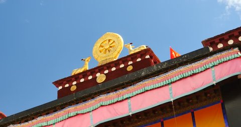 4k closeup of The Jokhang Temple In Lhasa,Tibet,white clouds in blue sky. gh2_09664_4k
