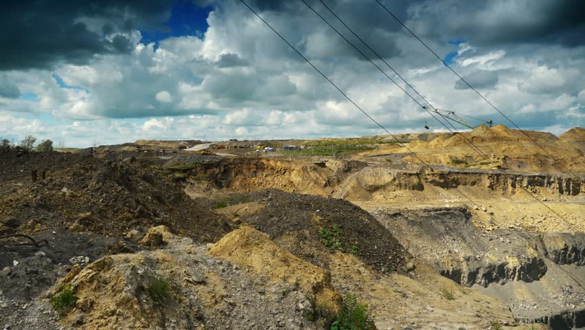 Coal production. Panning timelapse of opet pit mine