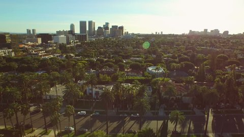 Los Angeles Aerial Beverly Hills v54 Side view low flying aerial over Beverly Hills neighborhood and downtown.
