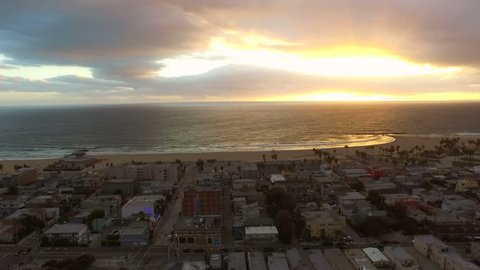 Los Angeles Aerial Venice Beach Sunset v89 Low flying aerial towards and over Venice beach during sunet.