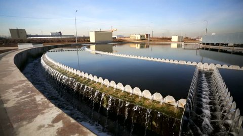 Sewage treatment plant - Waste water treatment (circular sedimentation tank). Purified water flows to the outlet and then to the river - outlet of treated sewage.