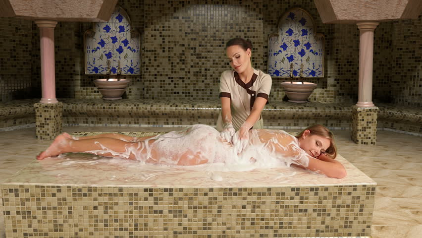 Girl enjoys of turetskim massage in hammam . Camera moves . Used dolly system