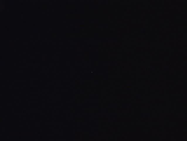 A ufo captured on video, pulsating light, traveling very quickly, inquisitive and hovering for a close look.  NTSC format.  | Shutterstock HD Video #93190