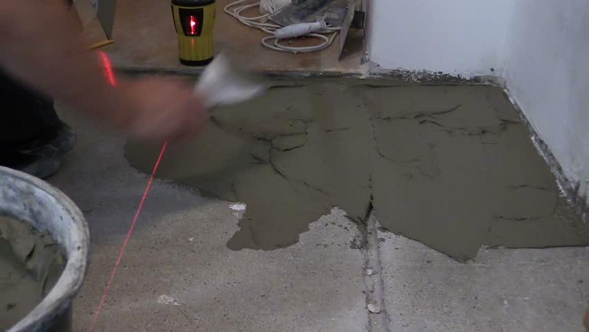 Stock video of Laying Ceramic Floor Tiles - Man Hand Spreading ...