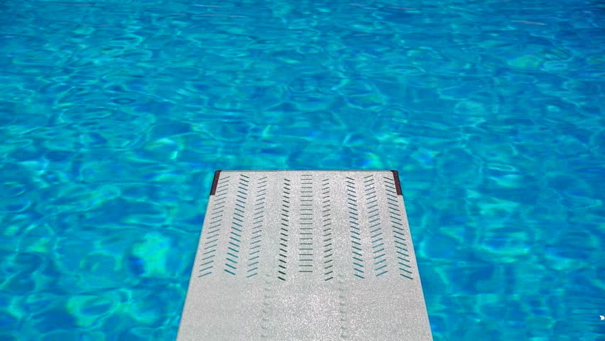 view from a trampoline in an olympic sport diving swimming pool with beautiful clear blue water
