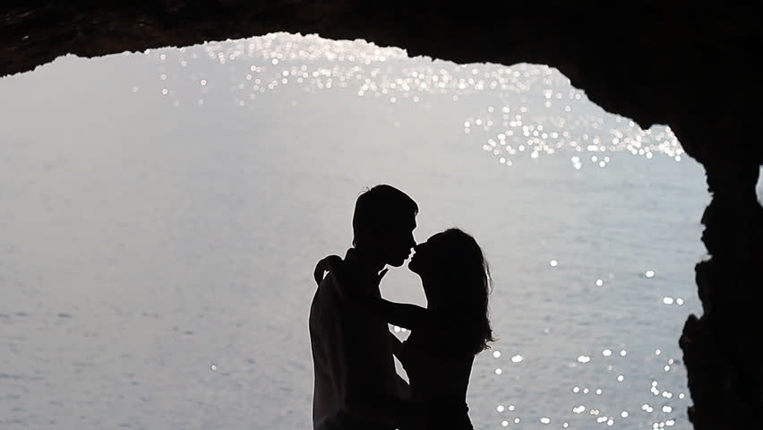 Silhouette of young couple in standing pose. Royalty Free
