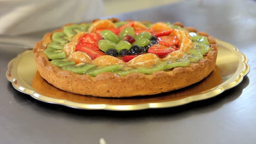 Hands pastry chef preparing a fruit tart    Shutterstock HD Video #9409880