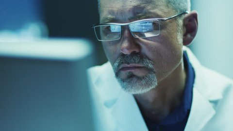 Serious and Focused Scientist Working on Computer. Shot on RED Cinema Camera in 4K (UHD).