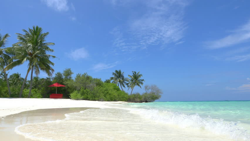 Empty daybed in exotic white sand lagoon | Shutterstock HD Video #9427010