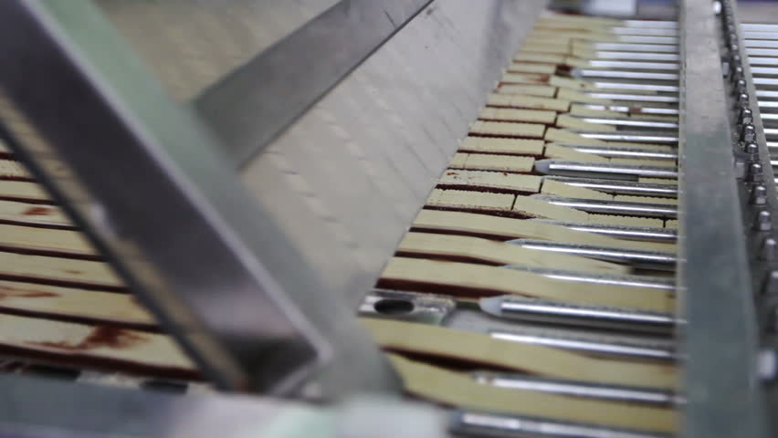 The manufacturing process of natural chocolates stuffed with wafer. Large factory. | Shutterstock HD Video #9460460